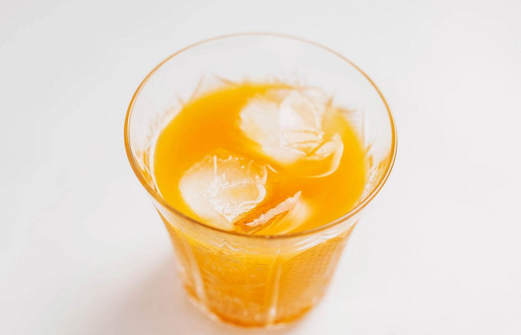 Multi vitamin orange juice in a glass