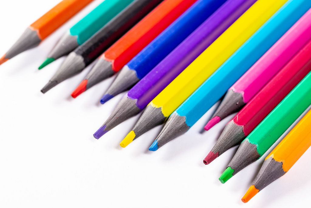 Multicolored pencils on white background