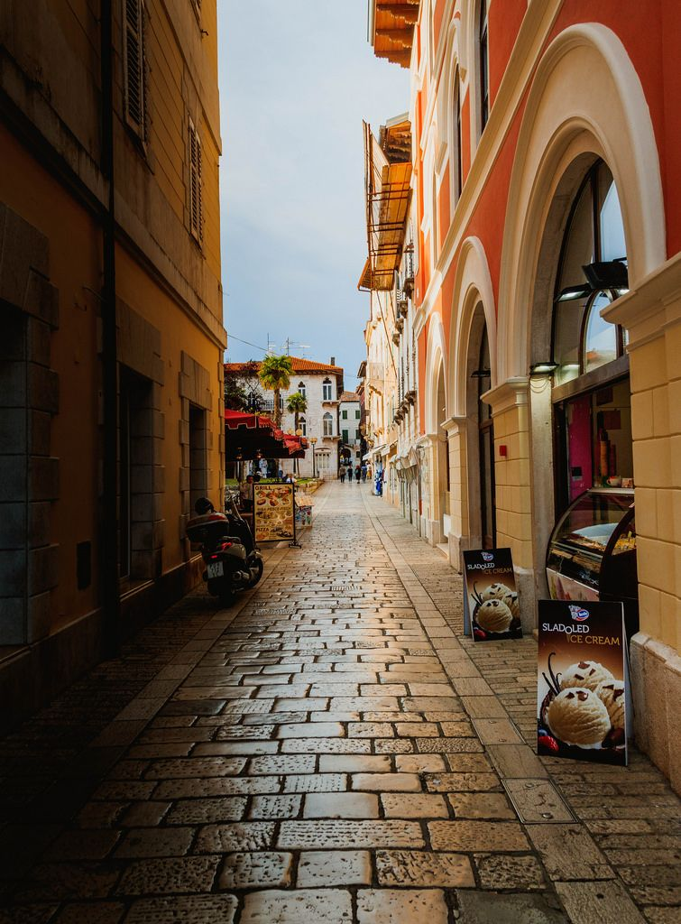 Narrow street in the historic centre, Porec, Istria, Croatia