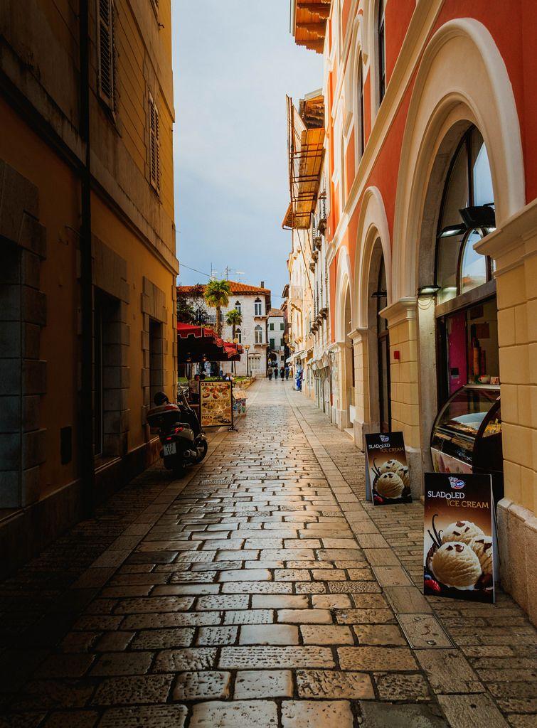 Narrow street in the historic centre, Porec, Istria, Croatia