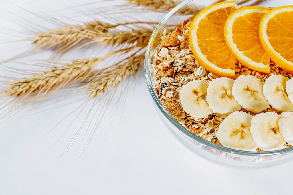 Natural healthy Breakfast-a variety of grain and cereals with orange and banana