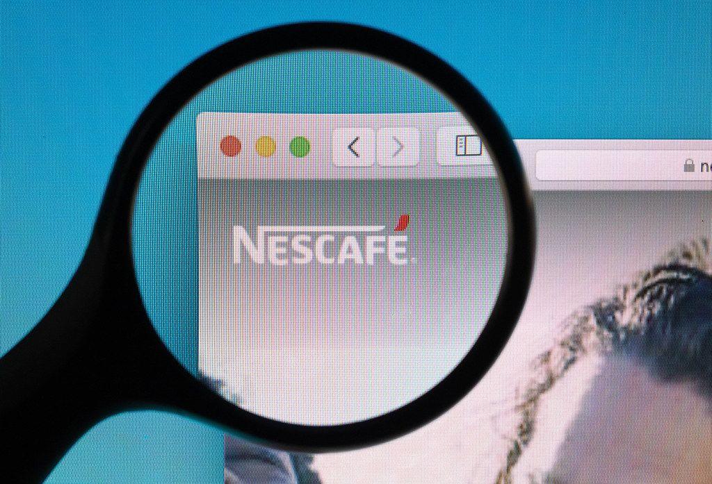Nescafe logo under magnifying glass
