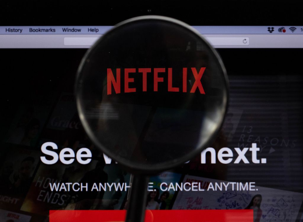 Netflix logo on a computer screen with a magnifying glass