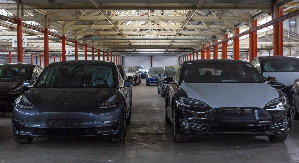 New Tesla Model 3 electro cars at the Tesla car warehouse in Neuss, Germany