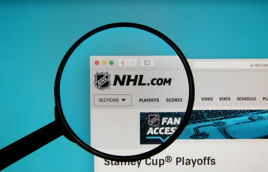 NHL logo on a computer screen with a magnifying glass