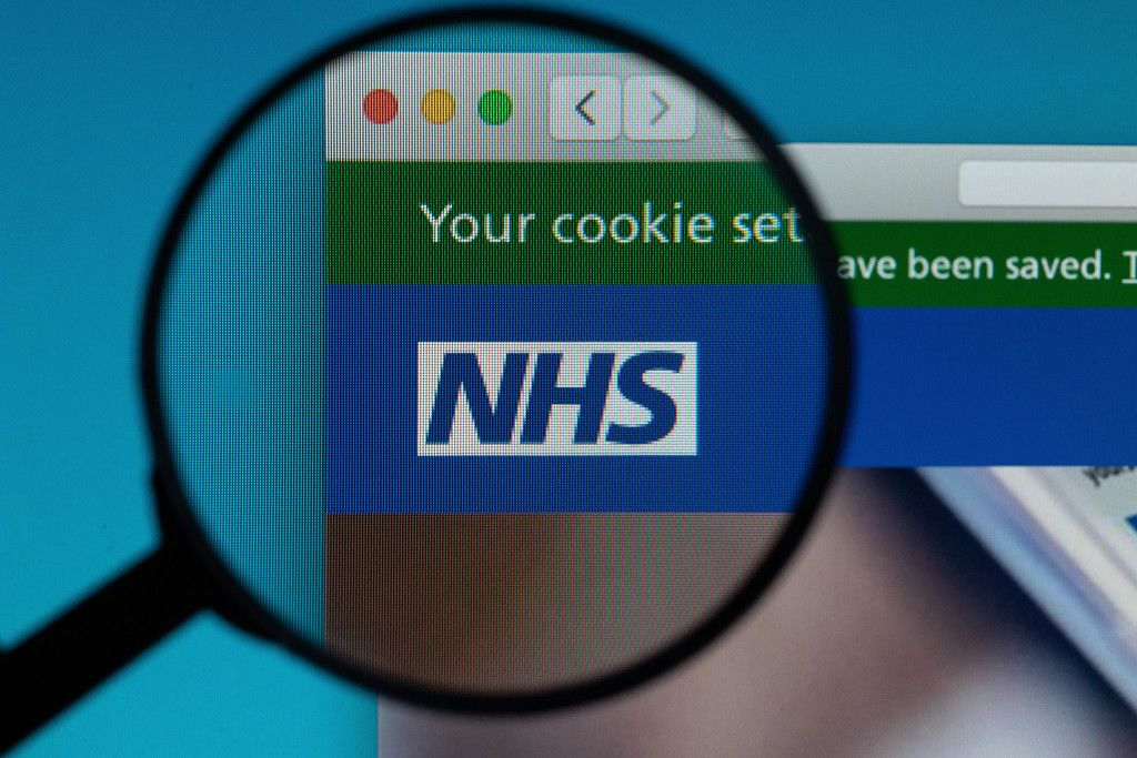 NHS logo under magnifying glass
