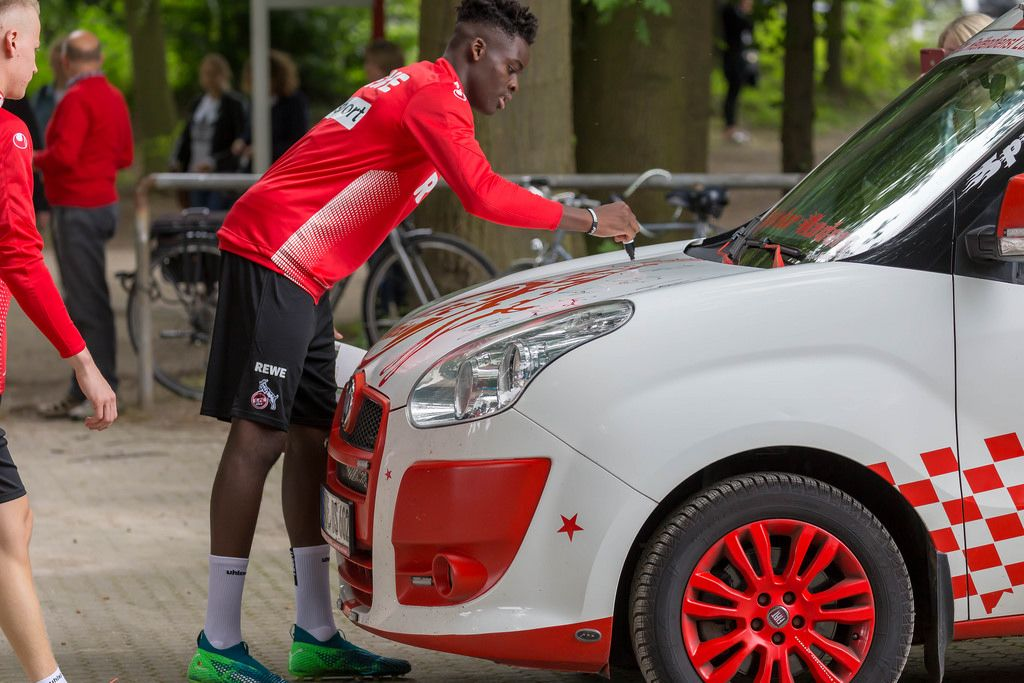 Nikolas Nartey signing a car