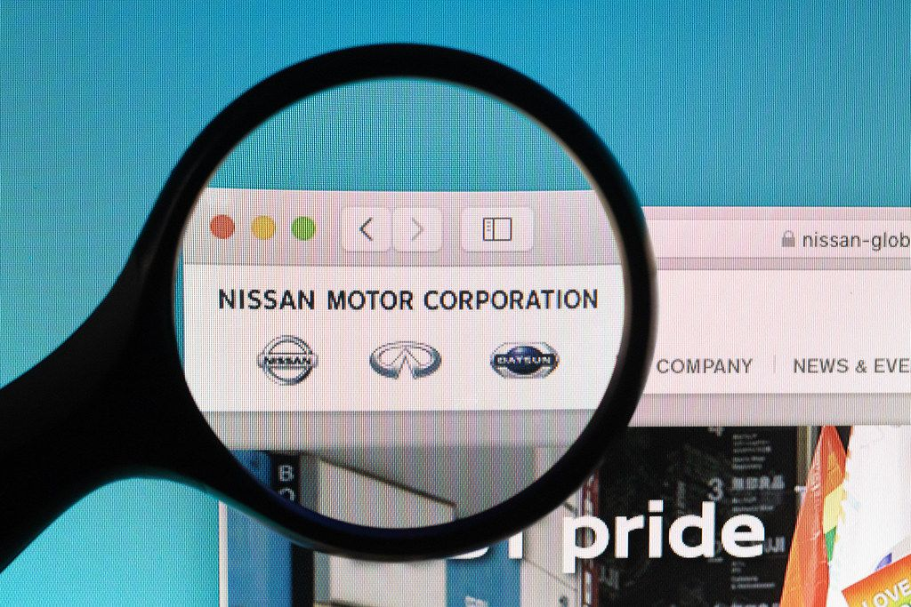 Nissan Motor Corporation logo under magnifying glass