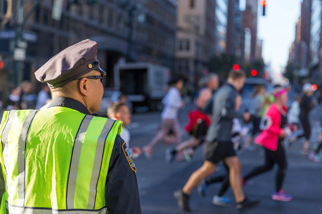 NYPD officer watching New York Marathon