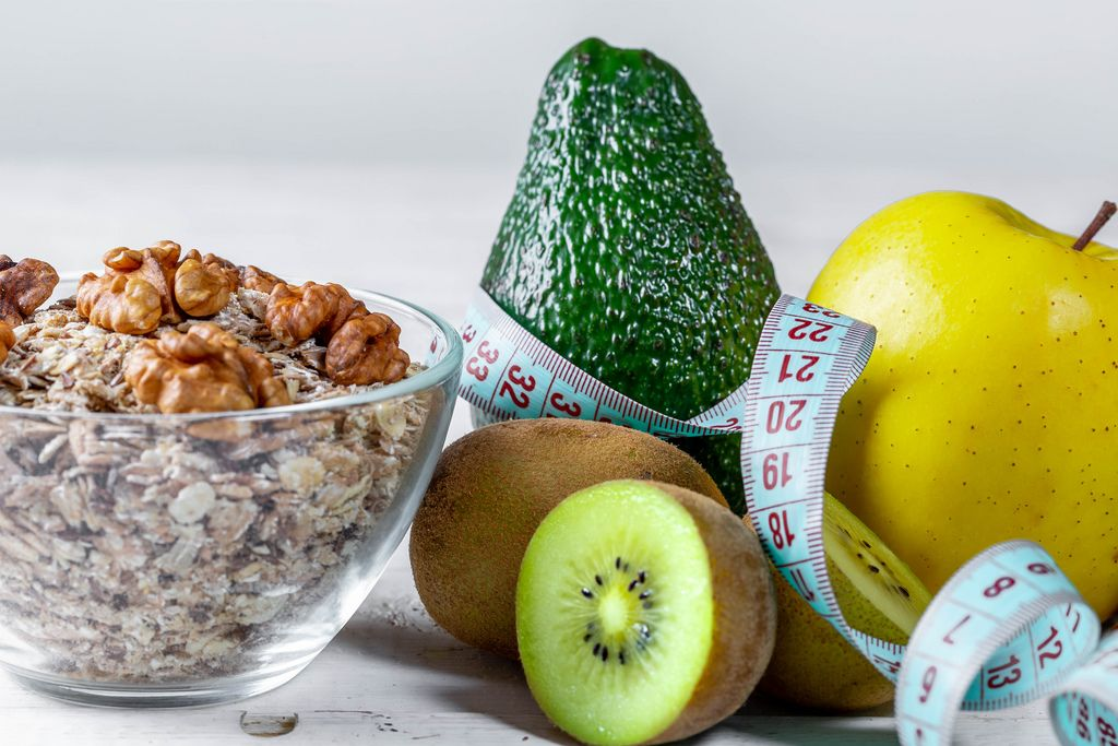 Oat flakes with fresh fruit and nuts and measuring tape