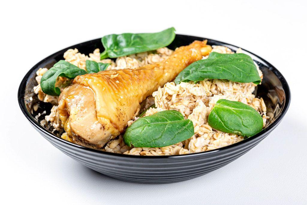 Oatmeal porridge with baked chicken leg