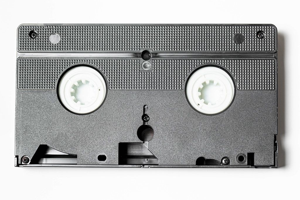 Old film videocassette on a white background