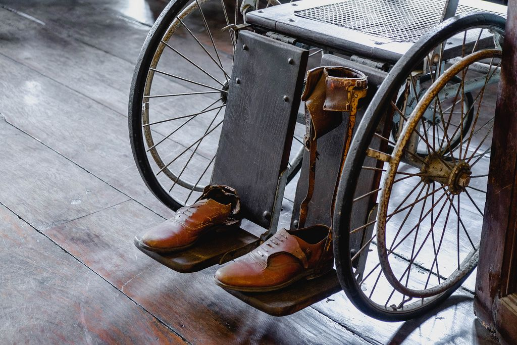 Old leather shoes on a vintage wwheelchair