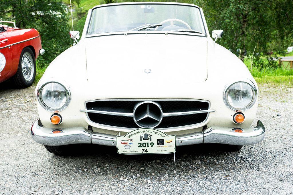 Old white Mercedes Benz car