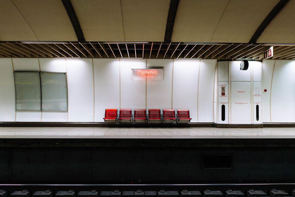 Omonia subway station neon sing in Athens, Greece