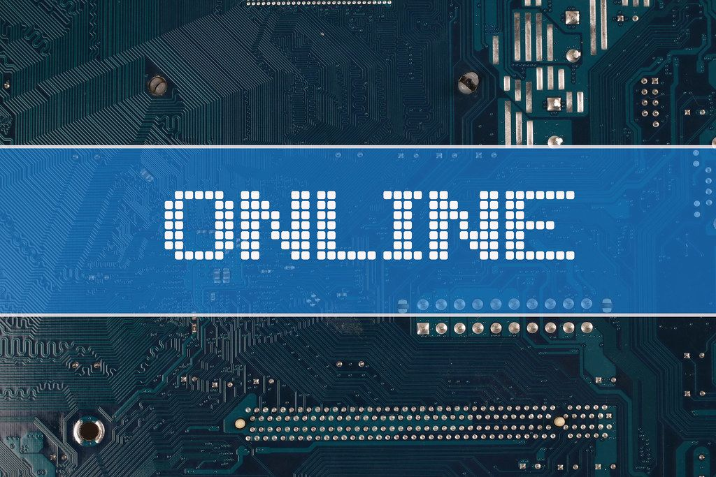 Online text over electronic circuit board background