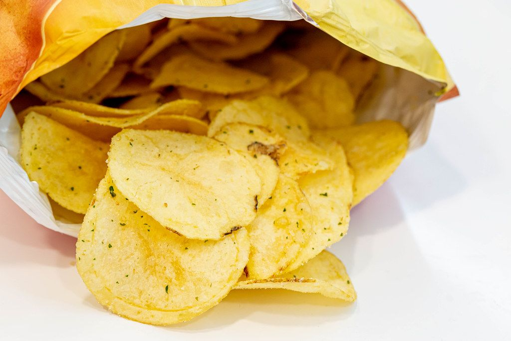 Open a package of potato chips
