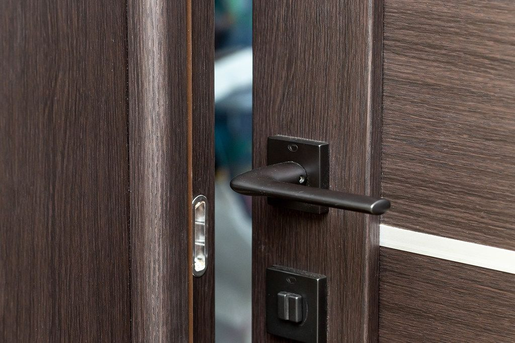 Open brown interior door with handle