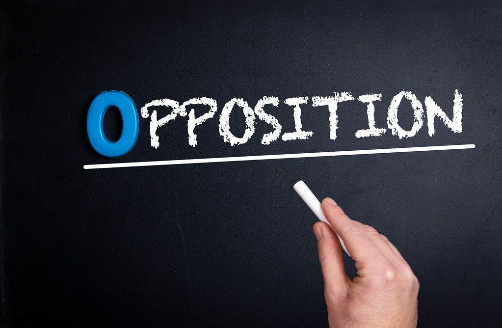Opposition text on blackboard