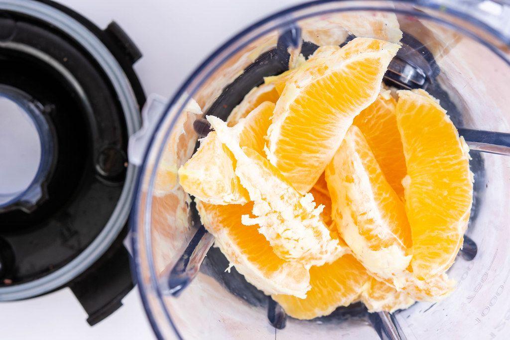 Orange fruit sliced in the juice mixer