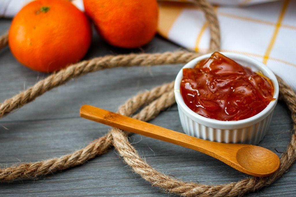 Orange Jam With Wooden Spoon