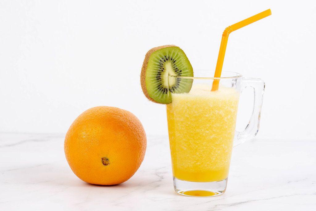 Orange juice in the glass with Kiwi