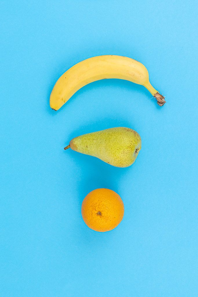 Orange Pear and Banana on the blue background as wifi internet sign