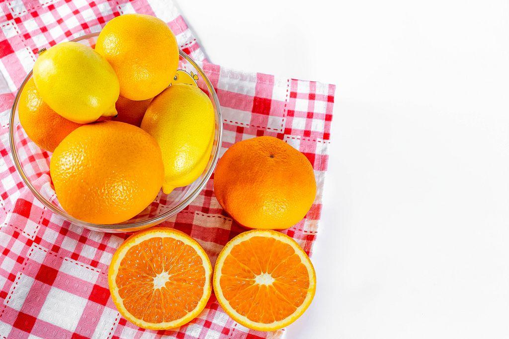 Oranges, lemons, tangerines in a glass bowl