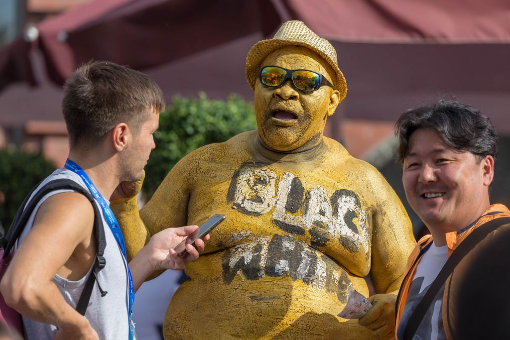 Overweight man with golden body pain being interviewed