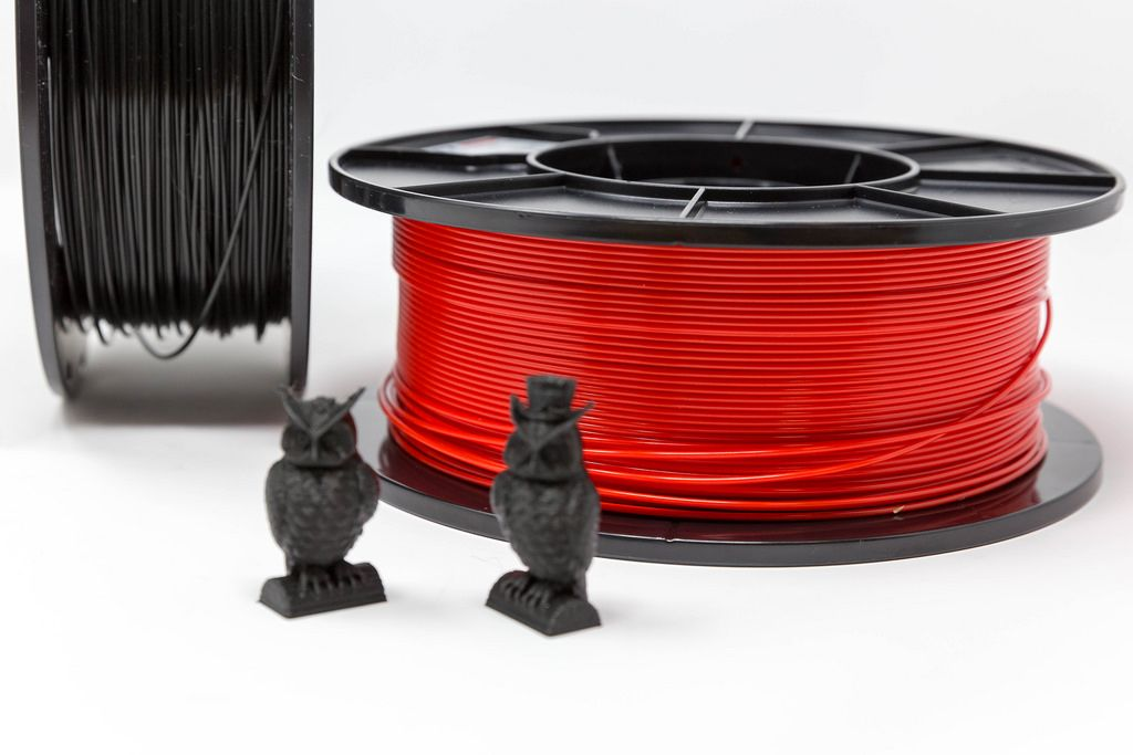 Owls made from black plastic in front of PLA filament