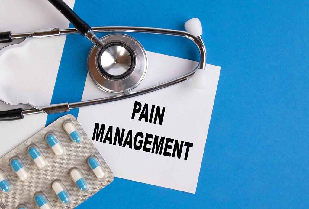 Pain management written on medical blue folder