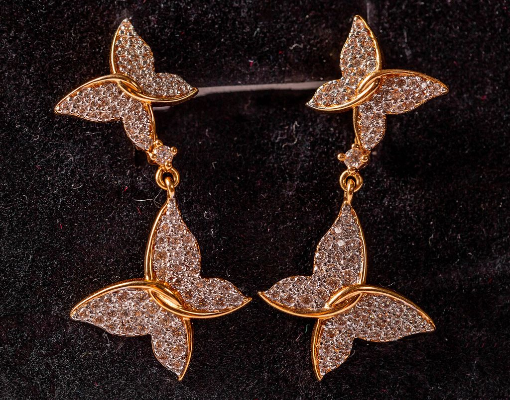 Pair of gold butterfly earrings