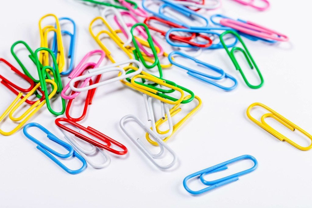 Paper clips on white background (Flip 2019)