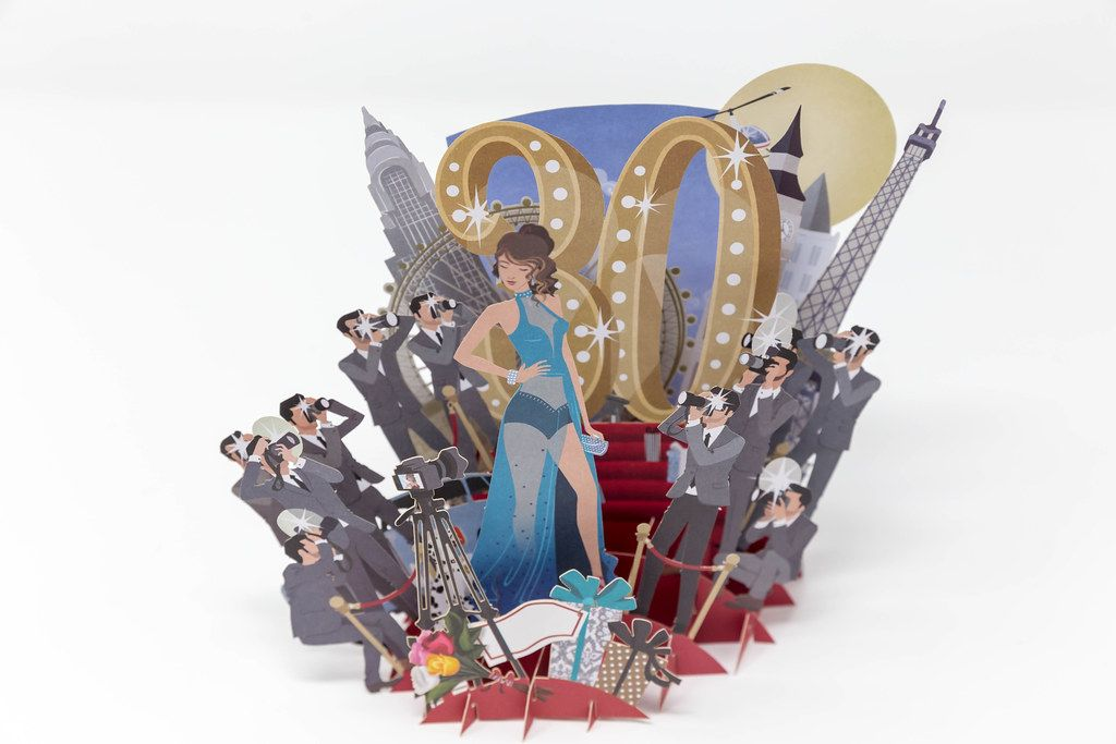 Paper model for the 30th birthday / anniversary, with a woman in the limelight and many photographers on the red carpet