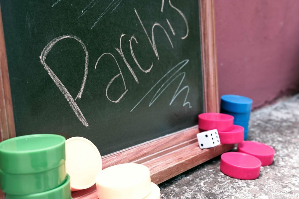 Parchís written on chalkboard