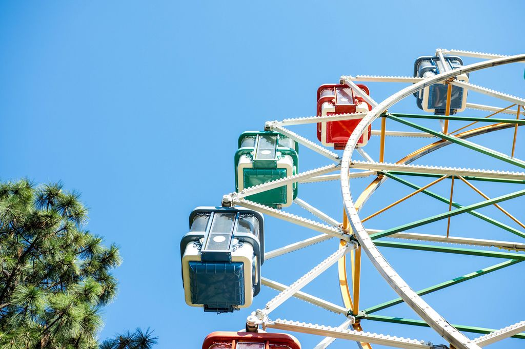 Part of a ferris wheel with blue sky behind