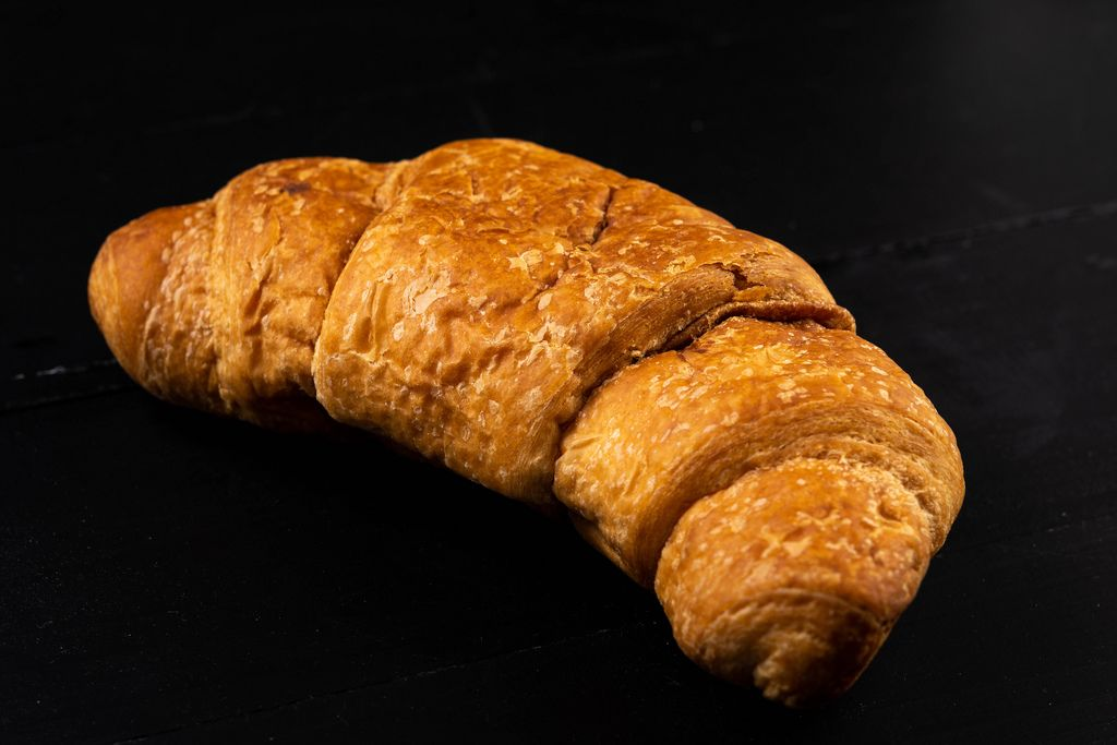 Pastry Croissant on the black background