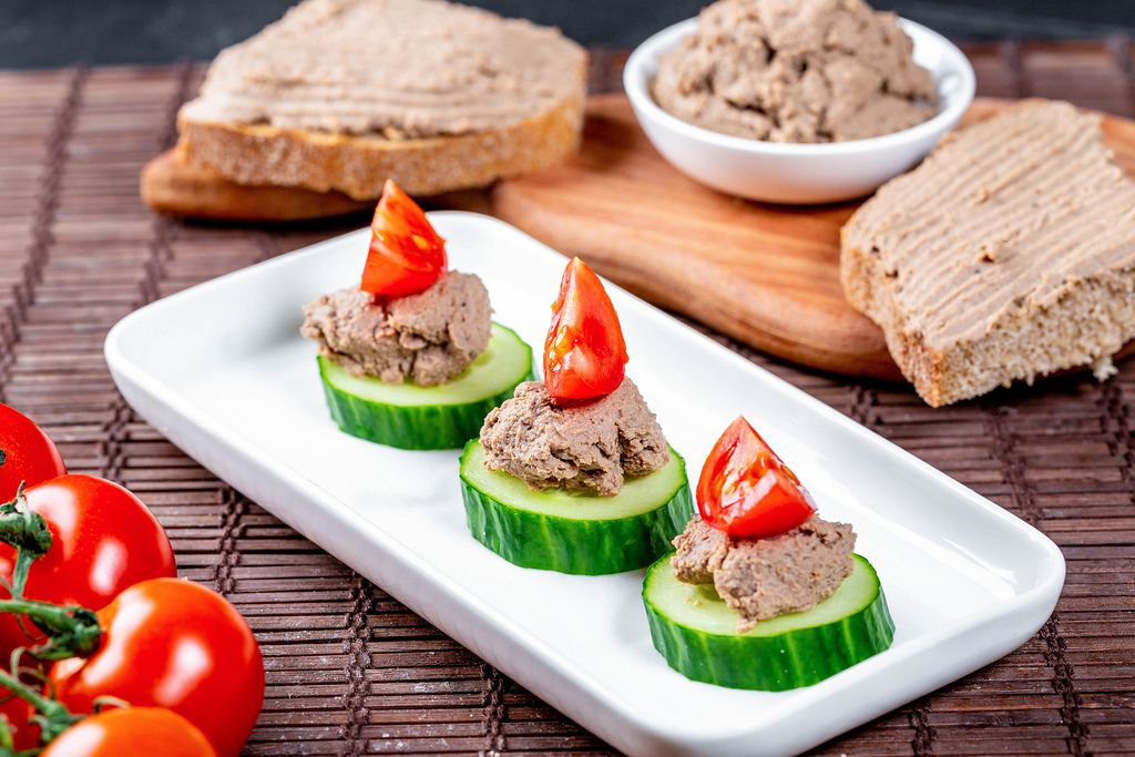 Pate on toast and cucumber slices with tomatoes