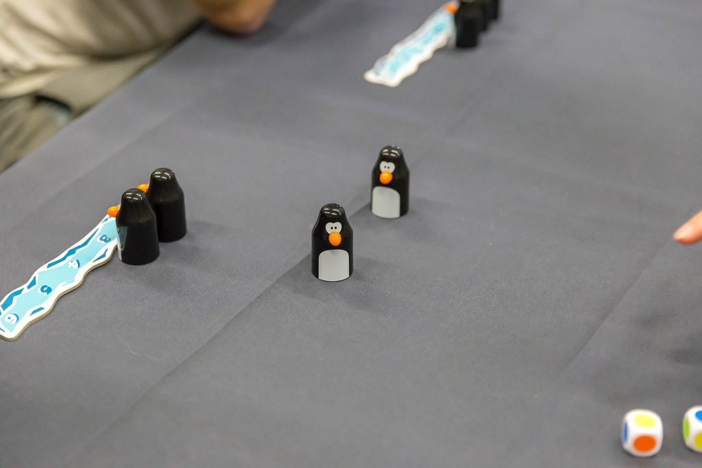 Penguin playing pieces and colorful dice