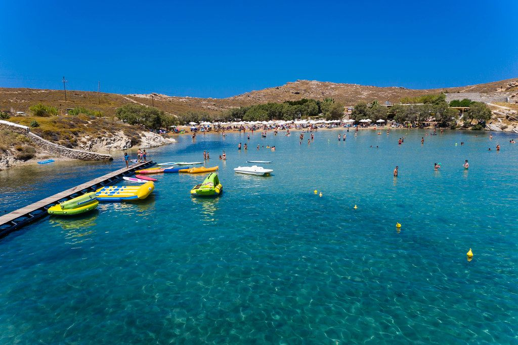 People during summer vacation swimming in the Mediterranean Sea, in front of Monastiri Beach of Korakas, on the Greek island of Paros