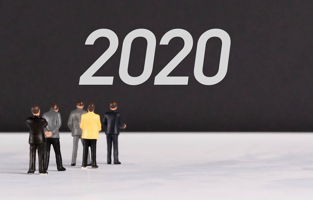 People standing in front of 2020 text