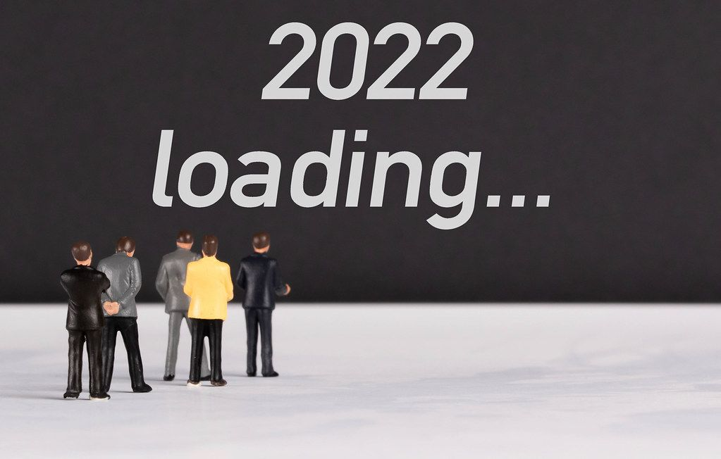 People standing in front of 2022 loading text