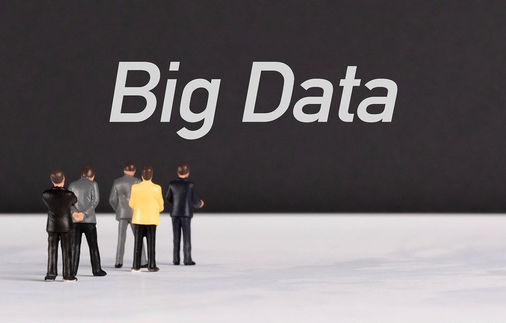 People standing in front of Big Data text