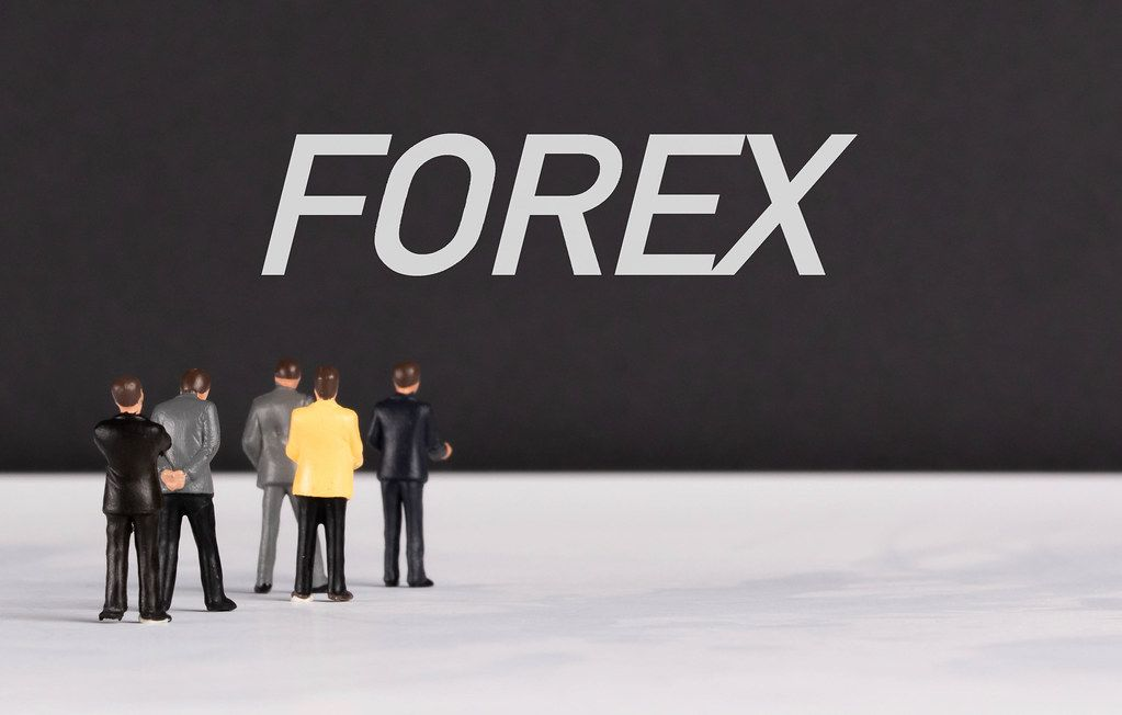 People standing in front of Forex text