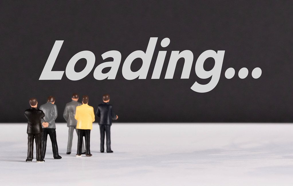 People standing in front of Loading text