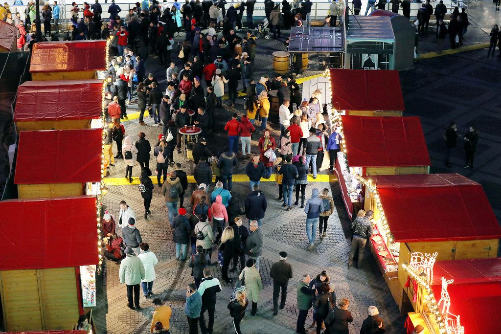 People walking between Christmas huts, view from above