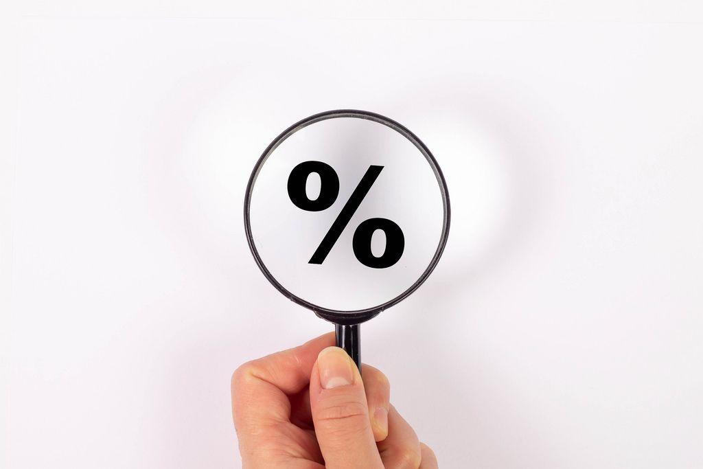 Percentage symbol under magnifying glass