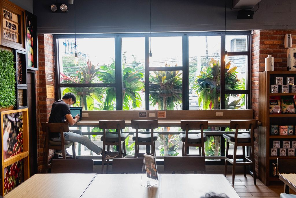 Person sitting on counter table at a local coffee shop in Bacolod