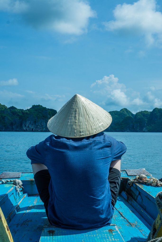 Person watching the Ha Long Bay Scenery from a Boat in Vietnam