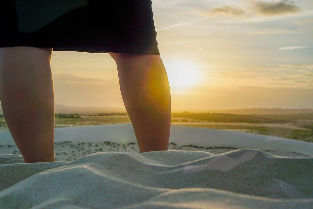 Person Watching the Sunset at Golden Hour in the White Sand Dunes of Mui Ne